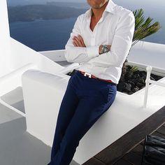 White shirt, blue trousers