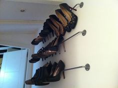 Use Bygel Kitchen Hangers from Ikea to store high heels in a closet.