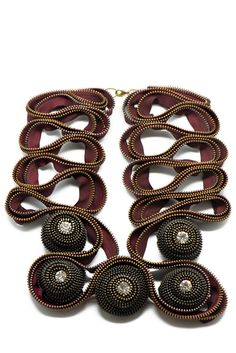 Naga Zipper Necklace. via The Cools