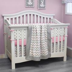 pink and gray chevron bedding with white crib