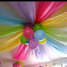 Cheap plastic table cloths from the dollar store + balloons. Fun idea