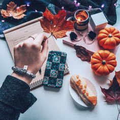 stylish and cozy autumn aesthic flatlay | autumn mood | cozy autumn flatlay inspiration | autumnal flatlay | little pumpkins | moroccan autumnal inspired BURGA green moroccan tiles phone case |autumn leaves and fairy lights cozy flatlay