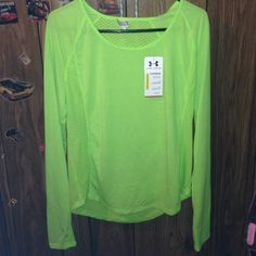 Nwt  underarmour heatgear shirt L running Brand new with tags,womens underarmour running shirt,size large,heatgear material,lightweight with mesh on sides and back,also has thumb holes,,,neon green color Under Armour Tops Tees - Long Sleeve