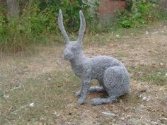 Metal wire #sculpture by #sculptor Lucia Corrigan titled: 'Sitting Hare (Metal Wire Mesh Outside garden/Yard life size sculpture)'. #LuciaCorrigan