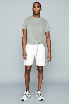 The Wenlock shorts in white, cut from a technical fabrication, are a smart-casual option with a design-led edge. Find the perfect pairing in our new arrivals. Mens White Shorts, Grey Shorts, Swim Shorts, Smart Casual, Casual Looks, Men Casual, Neck T Shirt, Lounge Wear, Manish
