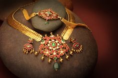 Indian Jewellery and Clothing: Awesome kasumala with heavy pendant and i love the jhumkas and bracelet too..