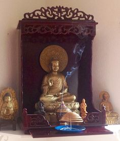 Atma Jyoti Blog:  Our Buddha shrine in the corner of our office. In front of the Buddha image is a reliquary containing relics of the Buddha given us by Thanissaro Bhikkhu of Metta Forest Monastery in Valley Center, California.