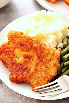 Pork Schnitzel - crispy and juicy schnitzel made with thin pork loin cutlets, lightly breaded and fried to golden perfection. Pure comfort food at it's best!