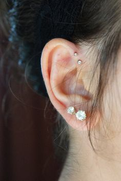 My forward helix piercings two at one time was quite painful, but pretty was worth the pain... I wanna get 3 so bad. Maybe one at a time though depending on the pain level...