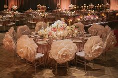 Giant paper flowers for wedding chair decor // Hall of Mirrors: Jin and Su's Glamorous Wedding at the Grand Hyatt Kuala Lumpur