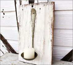 old ladle as candle holder. Would look really cure with a much more rustic ladle too.