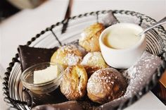 Abelskivers (Danish pancakes). With lemon curd. Dusting of powdered sugar. I make these for the kids on Christmas morning.
