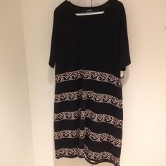 Black dress with striped design 56% cotton 44% acrylic. Also available in size 1X. Nine West Dresses