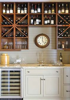 Kelsy....you should do this!  The clock above the sink...not the cabinets full of wine.