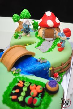 Smurf Village CakeSmurf mushroom cap 'house'/ village -themed decorated cake w/vegetable patch, stream and bridge, and surrounding fence. From KitchenStory on CakeCentral.com