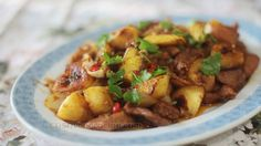 Stir-fried paprika-chili pork with pineapple and bananas