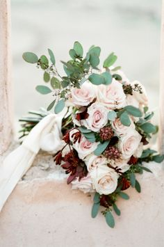 Pale blush and wine bouquet: http://www.stylemepretty.com/little-black-book-blog/2015/04/17/bohemian-desert-boudoir-session/ | Photography: Tamara Gruner - http://www.tamaragruner.com/
