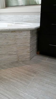 Amy Fruland-Smock s master bath tub and flooring