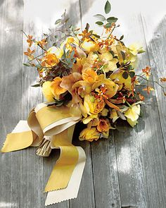 Yellow orchids, roses, and bunnytail grasses