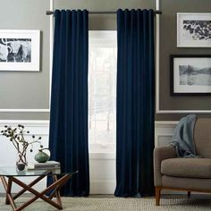 Make a bigger color statement with blue ceiling-to-floor curtains.