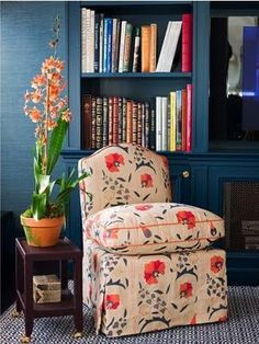 Fame room/ den by Ashley Whittaker. Love the Robert Kime fabric, the tiny welt, curved top of the slipper chair.