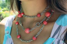 Necklace of coral beads and chains handmade. Three rows of different lengths