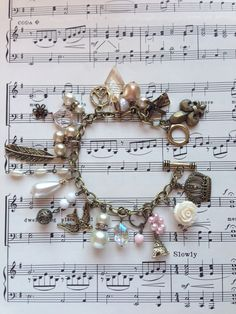 Really cute antique bronze vintage trinkets charm bracelet, created by Nicol Cook.