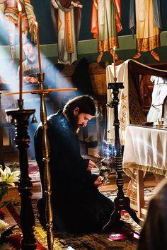 Romanian orthodox priest praying, Sucevita monastery, Bucovina