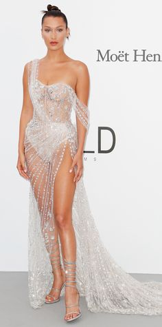 Leave it to Bella Hadid to constantly stun us with her jaw dropping Cannes Film Festival looks. While at the amfAR Gala, the supermodel radiated in a clear crystal embellished gown with a draping train and sky-high slit. A pair of sparkly strappy heels topped off the winning look.