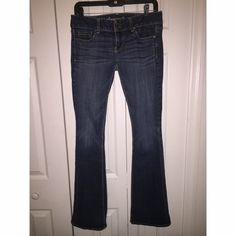 American Eagle Flair Jeans Artist Fit Flair/ low rise & long Jeans - My absolute favorite jeans. Great fit. Bottoms are a little torn and still in great shape. American Eagle Outfitters Jeans Boot Cut