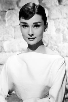 Audrey Hepburn - A sharp part, high shine and a pulled back style like Hepburn's let your face and neckline be the focus of your look. - Glamorous Wedding Hair Ideas