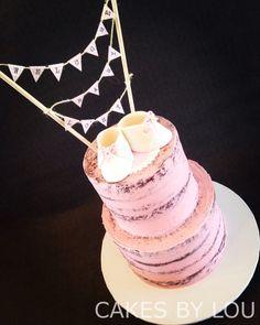 Pink naked baby shower cake - handmade gumpaste baby booties and handmade banner - chocolate mud cake with white chocolate ganache and vanilla buttercream
