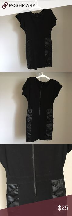 Sexy black dress Ferriano club fun! Cute lightly worn ferriano dress size medium. Great for a night out on the town or in the club. Fits like a glove. Stretchy material so easily caters to your body. ferriano Dresses Mini