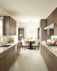 When picking your kitchen paint color consider any rooms that are connected to the kitchen, like a living room or dining room. To build cohesiveness between rooms consider painting or staining a room's trim to match any kitchen cabinets. Clean Kitchen Cabinets, Kitchen Chairs, Kitchen Dining, Kitchen Decor, Dark Cabinets, Kitchen Ideas, Home Depot Cabinets, Kitchen Designs, Kitchen Island