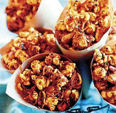 Coconut Curry Caramel Corn from Susan Feniger's Street Food cookbook. Sweet and spicy popcorn yummmmmmm