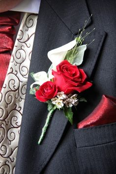 The Groom's rather special Boutonniere consisted of a luscious Red Rose, a Crystal Blush Calla Lily, Blossom and Dendrobium Orchid with a flourish of Champagne Grass