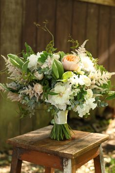 bridal bouquet by for a wedding at the Ault Park Rose Garden, by Floral Verde LLC in Cincinnati, Ohio; with Juliet garden roses, blush peoni...