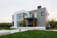 Alexandra Fedorova Designs an Elegant Contemporary House in Pestovo, Russia | HomeDSGN  ~ Great pin! For Oahu architectural design visit http://ownerbuiltdesign.com
