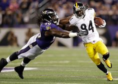 Steelers WR Antonio Brown trying to elude a dirty, stinking Baltimore Ravens defender.