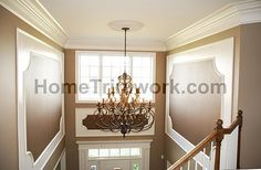 Picture Frames with Trim Above Front Door Accented with Chocolate Brown Paint