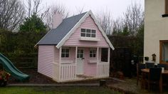 Play log house painted pink