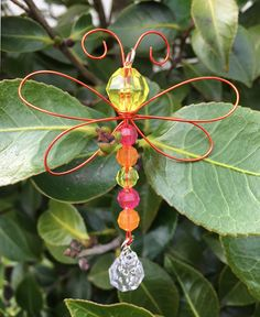 BEADED DRAGONFLY ON WIRE:  This is a really fun and colorful little guy to make! It's made with plastic faceted beads and colored wire. Use it to make jewelry, sun-catchers and garden mobiles!