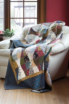 Even if you've never sewn curved blocks or have always avoided them, give it a try. Cathy Wierzbicki's ingenious method and cutting tool makes it totally foolproof. The Quilter's Versa-Curve ruler makes these curved four-patch units foolproof, and when pieced together, give the illusion of waves down the quilt. Look for Hills & Valleys in Scrap Quilts Spring '15.