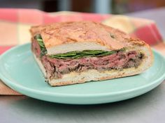 Jeff Mauro's Ultimate Steak and Mushroom Shooter Sandwich ~ Was really cool how he made this in a large hallowed out bread and then flattened it with weight.. Have to make this.