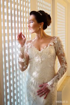 Beautiful lace sleeve wedding dress   SouthBound Bride   http://www.southboundbride.com/floral-romance-wedding-at-the-oyster-box-hotel-by-vivid-blue-photography-kerry-marinus   Credit: Vivid Blue Photography