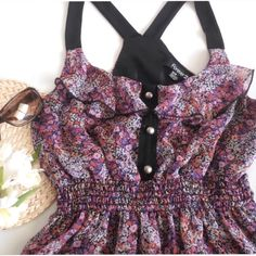 """Forever 21 Floral Top Size M.  Laying flat it measures about 15"""" armpit to armpit and 25"""" long..  Shell and lining are 100% polyester.  This top has a smocked waist, ruffled neckline and racerback.  Pre-owned but gently used.  No trades. Forever 21 Tops Blouses"""