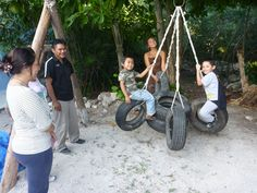 Multiple riders tire swing