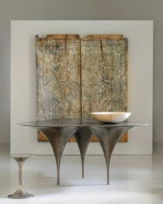The carved wood looks like a Sulawesi house panel.  Furnishings at Carlo Showroom.    Courtesy of Carlo Pessina