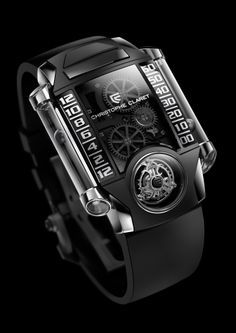 X-TREM-1 with platinum and black grade 5 titanium case. Two tiny hollowed steel spheres, isolated within sapphire tubes on the left and right sides of the caseband magically move with no mechanical connection thanks to magnetic fields. For more information, please visit: http://www.christopheclaret.com/en/collection-x-trem-1-c7-p11.php