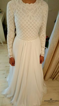 Modest wedding gown with long sleeves. Fittings at Studio Levana